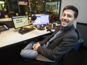 Elias Makos tries out the host's chair in the studio at CJAD in Montreal Monday December 17, 2018 after the station announced he will be taking over the mid-morning hosting duties.