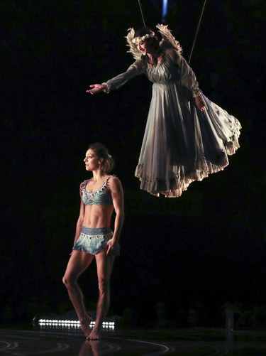 An angel floats above a gymnast during opening night performance of Cirque du Soleil's Corteo in Montreal Dec. 19, 2018.
