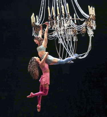 Acrobats signifying dead clown Mauro's former lovers swing from the chandelier during opening night performance of Cirque du Soleil's Corteo in Montreal Dec. 19, 2018.