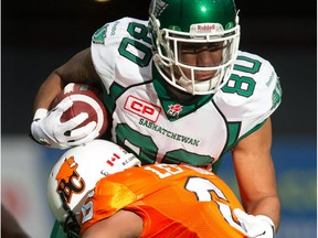 Saskatchewan Roughriders' Spencer Moore is tackled by B.C. Lions' T.J. Lee after making a reception during the first half in Vancouver on Oct. 3, 2015.