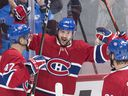 Canadiens' Tomas Tatar (90) celebrates with teammates Kenny Agostino (47) and David Schlemko after scoring against the New York Rangers in Montreal on Saturday, Dec. 1, 2018.