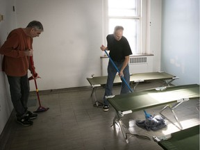 Richard Dominique, left, and Stephane Houle clean up one of the rooms available for the homeless at the old Royal Victoria Hospital site on Thursday January 17, 2019.