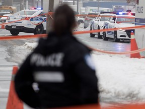 Montreal police investigate the scene where Tony Magi was shot in Montreal on Thursday.