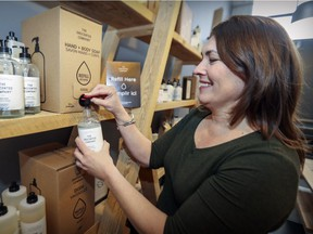 Anie Rouleau, founder of The Unscented Company, fills a dispenser with soap at the company's office/warehouse in Montreal.