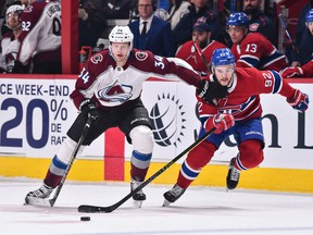 Carl Soderberg of the Colorado Avalanche, left, and Canadiens' Jonathan Drouin skate after the puck at the Bell Centre on Saturday, Jan. 12, 2019, in Montreal.