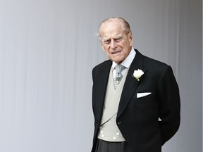 FILE - In this Friday, Oct. 12, 2018 file photo, Britain's Prince Philip waits for the bridal procession following the wedding of Princess Eugenie of York and Jack Brooksbank in St George's Chapel, Windsor Castle, near London, England. Prince Philip, the 97-year-old husband of Queen Elizabeth II, has apologized to a mother-of-two who was injured when the car she was riding in collided with a Land Rover he was driving on Jan. 17, 2019.