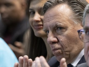 Quebec Premier François Legault, right, and Public Security Minister Geneviève Guilbault during a memorial ceremony to honour the victims of the 2017 mosque shooting Tuesday in Quebec City. Two days later, Legault says there is no islamophobia in Quebec, contradicting Guilbault who said the government would look at the idea of a day against islamophobia.