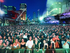 Fans fill Place des Festivals to watch Jessie Reyez perform at a free outdoor show during the 2018 Montreal International Jazz Festival.