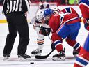 Leon Draisaitl of the Edmonton Oilers and Canadiens' Paul Byron take a face-off at the Bell Centre on Sunday, Feb. 3, 2019, in Montreal.