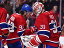 The Canadiens' Jonathan Drouin congratulates goalie Carey Price after 5-2 victory over the Winnipeg Jets during NHL game at the Bell Centre in Montreal on Thursday, Feb. 7, 2019.