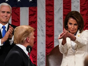 Donald Trump arrives to deliver the State of the Union address, alongside Speaker of the House Nancy Pelosi and Vice-President Mike Pence, at the U.S. Capitol in Washington, D.C., on February 5, 2019.