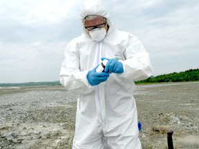 """These tailings are still an active source of asbestos dust in these communities,"" says Daniel Green, toxicologist and deputy leader of the federal Green Party, shown here sampling residues in Danville during a TV episode titled Asbestos: From a Blessing to a Curse."