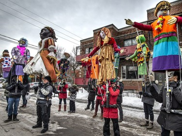 Members of the Italian community carrying marionettes take their positions as they prepare to parade through Little Italy in Montreal, on Saturday, March 2, 2019.