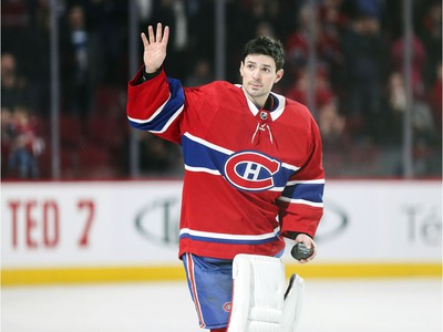 Montreal Canadiens' Carey Price acknowledges applause after breaking Jacques Plante's record for most wins by a Habs goalie following victory over the Detroit Red Wings in Montreal Tuesday March 12, 2019.