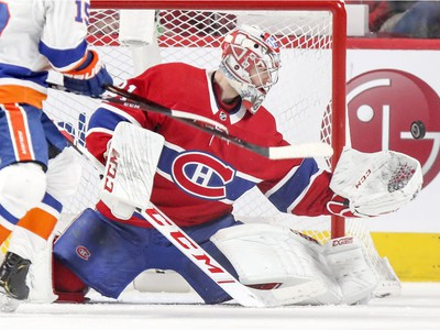 Canadiens' Carey Price makes a glove save during third period at the Bell centre Thursday night.
