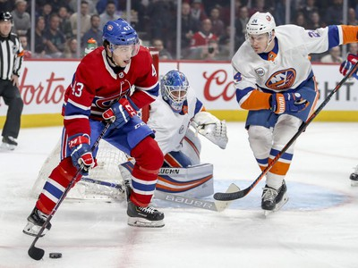 Montreal Canadiens' Jordan Weal looks to make a pass next to New York Islanders goalie Thomas Greiss and defenceman Scott Mayfield during first period of National Hockey League game in Montreal Thursday March 21, 2019.