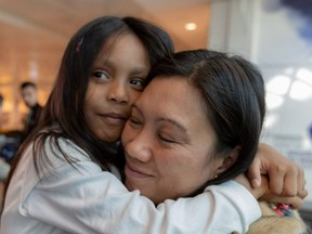 Vanessa Rodel and her 7-year-old daughter, Keana, at Trudeau airport on Tuesday.