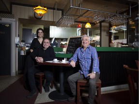 """Playwright Vittorio Rossi, centre, at Pizza Nino with co-owners Frank Pino and his niece Cynthia Pino. """"Traditional neighbourhoods like Ville-Émard need family-run places like this,"""" Rossi says."""