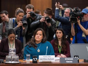 """(FILES) In this file photo taken on February 27, 2019 Former Canadian Justice Minister Jody Wilson-Raybould arrives to give her testimony about the SNC-LAVALIN affair before a justice committee hearing on Parliament Hill in Ottawa on February 27, 2019. - Canada's former attorney general has provoked the worst political crisis for Prime Minister Justin Trudeau's Liberal government by accusing senior officials of attempting to head off the fraud prosecution of engineering giant SNC-Lavalin. Jody Wilson-Raybould testified at the House of Commons Justice Committee that Trudeau, one of his ministers and close advisors applied """"inappropriate"""" pressure on her, including """"veiled threats"""" to intervene in a criminal prosecution."""