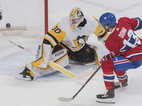 Pittsburgh Penguins goaltender Matt Murray makes a save against Montreal Canadiens' Max Domi during first period NHL hockey action in Montreal, Saturday, March 2, 2019.