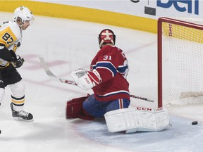 Pittsburgh Penguins' Sidney Crosby (87) scores on Montreal Canadiens goaltender Carey Price during first period NHL hockey action in Montreal, Saturday, March 2, 2019.