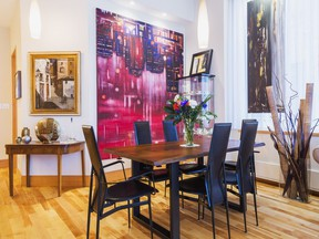 Three large paintings by the Armenian artist Garen Bedrossian dominate the decor in the dining room.