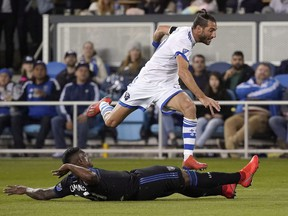 Montreal Impact midfielder Ignacio Piatti leaps over San Jose Earthquakes defender Harold Cummings during the second half in San Jose, Calif., on March 2, 2019.