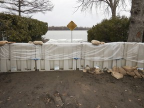 A flood barrier is in place at the foot of de Gaulle St. in the Pierrefonds-Roxboro borough Thursday April 18, 2019.