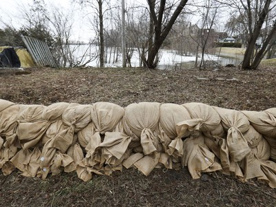 A row of sandbags line a property on de Gaule St. in the Pierrefonds-Roxboro borough of Montreal Thursday April 18, 2019.