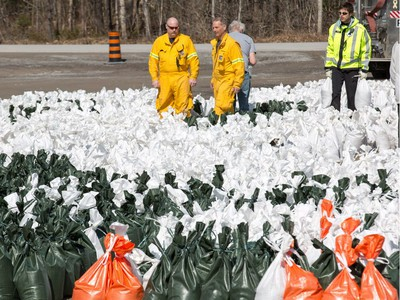 Volunteers at the Constance Bay Community Centre get busy filling sandbags and using them to protect their homes in anticipation of rising water from the Ottawa River.