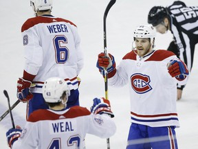 Montreal Canadiens' Jordan Weal (43) and Andrew Shaw (65) celebrate Weal's empty-net goal against the Jets in Winnipeg on March 28, 2019.
