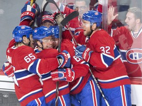 Canadiens centre Max Domi, second left, is congratulated after scoring Montreal's fourth goal Tuesday night at the Bell Centre.
