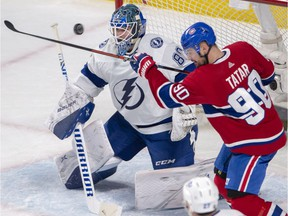 Montreal Canadiens left-winger Tomas Tatar tries to tip in a loose puck in front of Tampa Bay Lightning goaltender Edward Pasquale during second period on Tuesday, April 2, 2019, in Montreal.