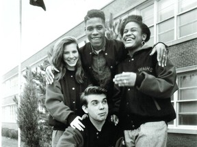Steffan Watkins, 16, (kneeling), with from left Tammie Woodley, 17, John Jones, 15,  and Nadine Francis, 16 outside West Hill High School on April 22, 1992. Another photo of the four students accompanied a feature on high school graduations a month later.