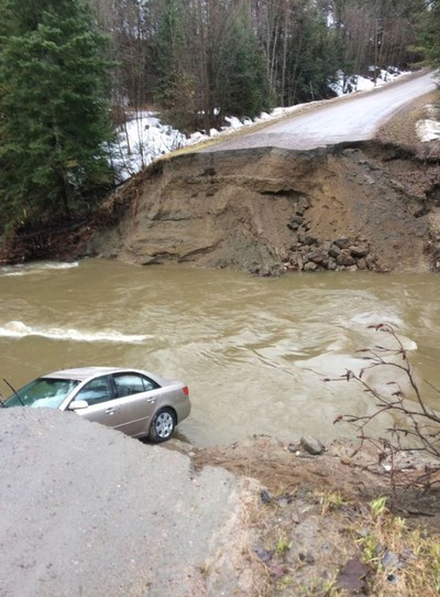 A vehicle is seen in a gaping hole in the road in the Municipality of Pontiac, about 30 km northwest of Ottawa in this photo posted on the Twitter page of MRC des Collines-de-l'Outaouais. One person has died amid flooding in western Quebec, after rising river levels swept away part of a road in the Outaouais region overnight. Police confirmed the death in a tweet Saturday morning, posting a photo of a gaping hole along the road in the Municipality of Pontiac, about 30 km northwest of Ottawa.