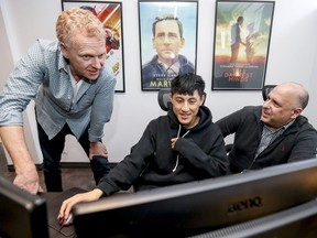 Lead compositing instructor Fortunato Frattasio, right, and lead lead FX instructor Sean Lewkiw check in with graduating student David Gao at Lost Boys Studio's Montreal School of Visual Effects.
