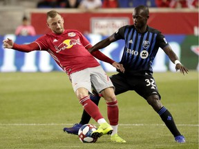Montreal Impact midfielder Micheal Azira, right, battles New York Red Bulls' Daniel Royer during second half on May 8, 2019, in Harrison, N.J. The Impact won 2-1.