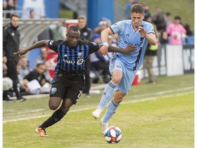 Montreal Impact's Zachary Brault-Guillard, left, challenges New York FC's Ben Sweat during second half MLS soccer action in Montreal on Saturday, May 4, 2019.