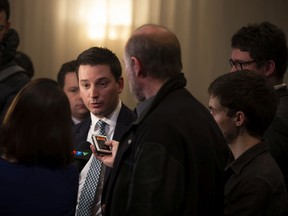 """""""I am sure we can adopt the two bills by Friday of this week,"""" Simon Jolin-Barrette told reporters, seen here in April speaking to the media."""