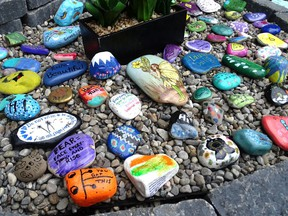 A kindness garden in Brantford, Ont. features rocks painted with messages of kindness and positivity, and passers-by are invited to take them. If news about acts of kindness often goes viral, it's because other things are causing people to lose faith in humanity, Martine St-Victor says.