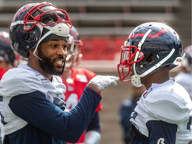 The Montreal Alouettes wide receiver BJ Cunningham, left, and wide receiver Zac Parker chat during spring training camp at Percival Molson Stadium in Montreal on Monday June 3, 2019.