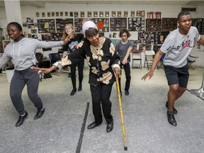 Ethel Bruneu teaches tap to Kyle Briggs and his sister Ericka, left, and Victoia McHugh and Raene Collins-St-Louis, rear, in her studio in Dorval last Friday.