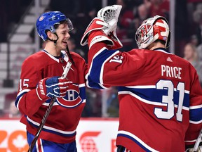 Jesperi Kotkaniemi celebrates a victory with Carey Price against the Washington Capitals at Montreal's Bell Centre on November 1, 2018.
