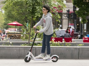 Timothy Baldacchino of Dyad Cycles rides an electric scooter around Prince Arthur St. last week.