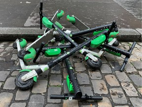 Dock-free electric scooters by California-based bicycle sharing service Lime are stacked on Parisian cobblestones in a street in Paris, France, May 19, 2019.