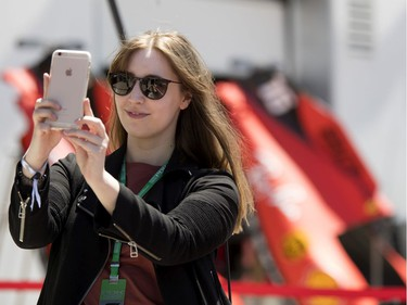 Lyndsey Welch  of Calgary takes a selfie with Ferrari car parts during the annual Grand Prix open house at Circuit Gilles Villeneuve  in Montreal on Thursday, June 6, 2019.