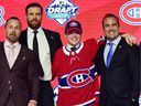 Canadiens draft pick Cole Caufield, second from right, poses with assistant GM Trevor Timmins, left, captain Shea Weber and owner Geoff Molson after being selected 15th overall Friday night in Vancouver.