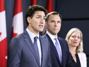 Prime Minister Justin Trudeau speaks during a news conference about the government's decision on the Trans Mountain Expansion Project, with Finance Minister Bill Morneau and Environment Minister Catherine McKenna in Ottawa on June 18, 2019.