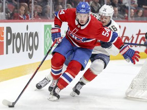 Montreal Canadiens' Charles Hudon holds off Florida Panthers' Aleksander Barkov during first period in Montreal on March 19, 2018.