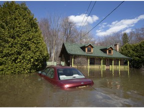 A submerged car is seen in Ste-Marthe-sur-le-Lac on April 30, 2019.